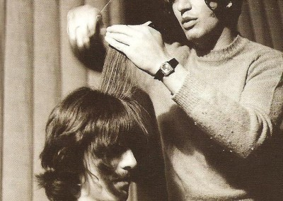 George Harrison having his hair cut by Leslie Cavendish